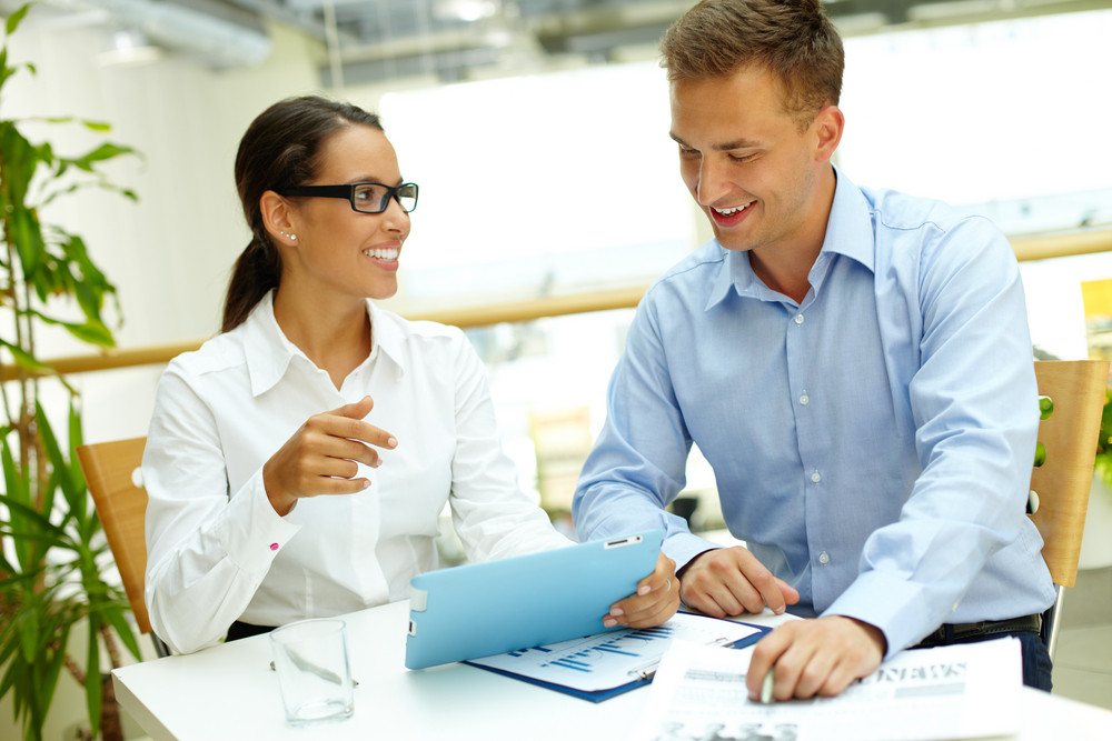 Happy Business Partners With Touchpad Planning Work At Meeting