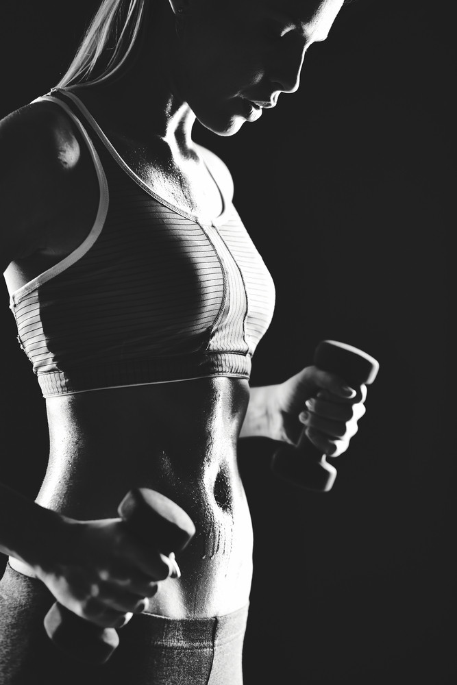 Image Of Slim Female In Activewear Doing Exercise With Dumbbells