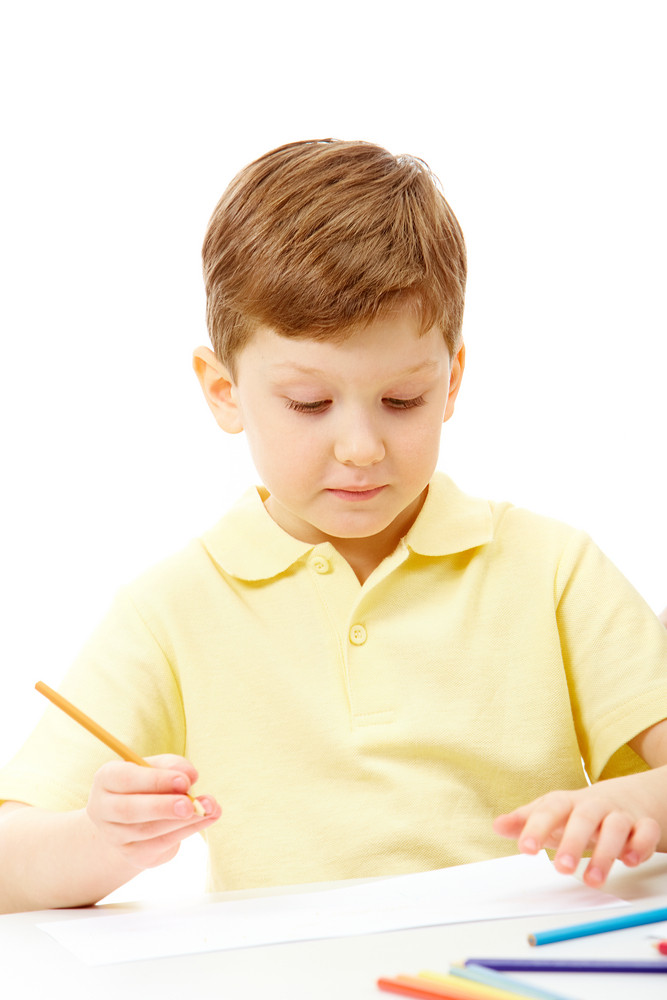 Boy With Paper And Pencils
