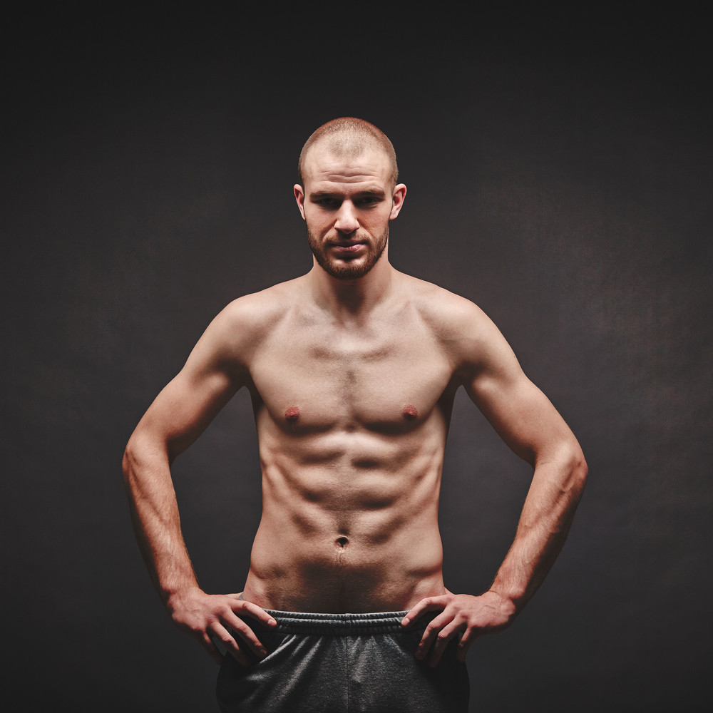 Image Of Topless Man Posing In The Darkness