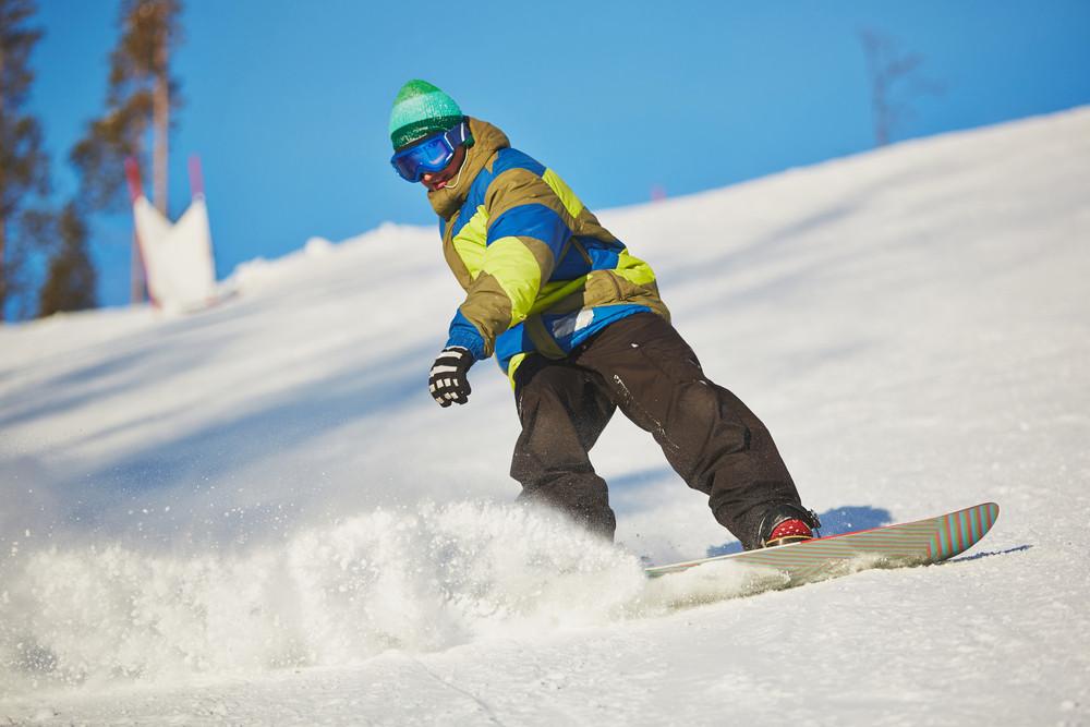 Active Sportsman Snowboarding In Snowdrift