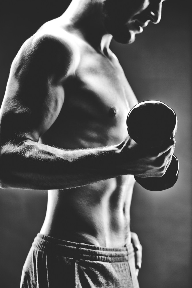 Image Of Handsome Man With Bare Torso Doing Exercise With Barbell