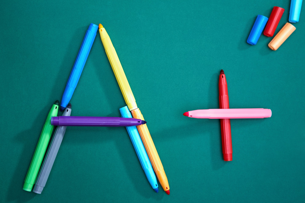 Close-up Of Colorful Highlighters On Blackboard