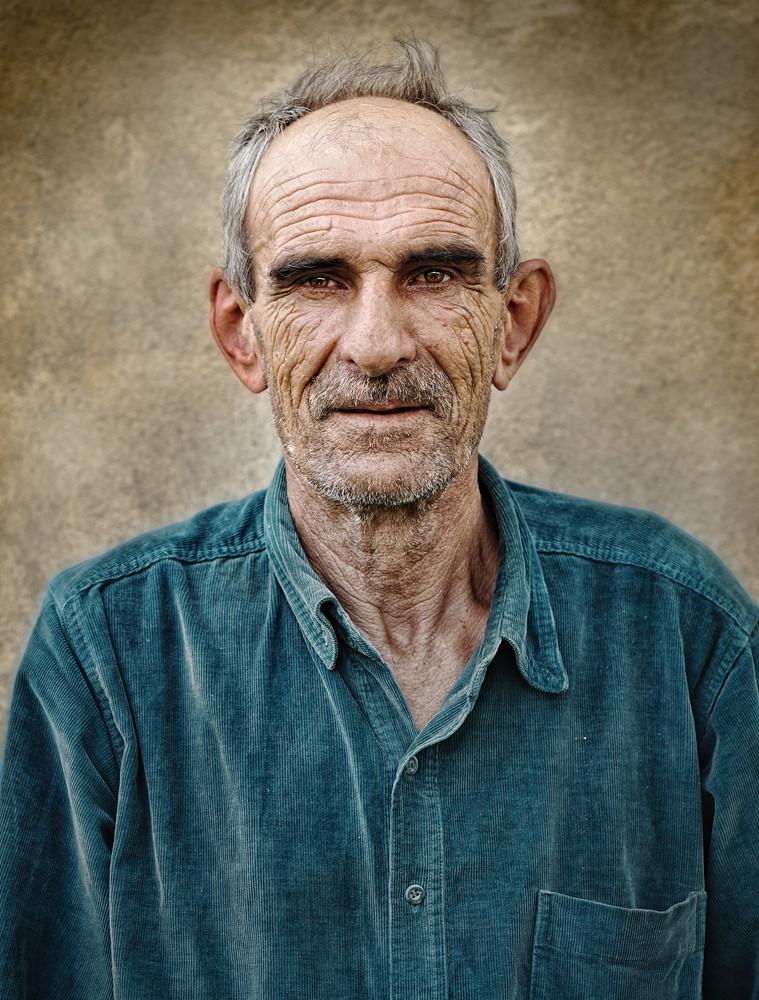 Artistic old photo of elderly bald man