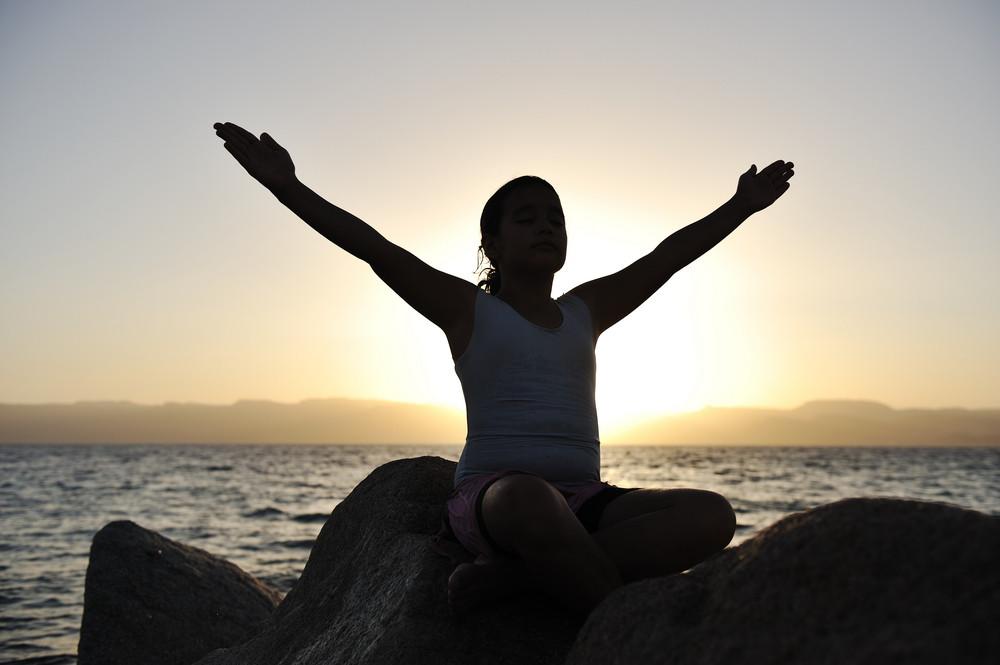 Girl on sunset excercising