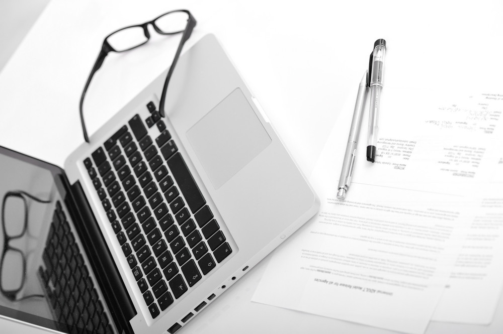 Laptop and agreement documents