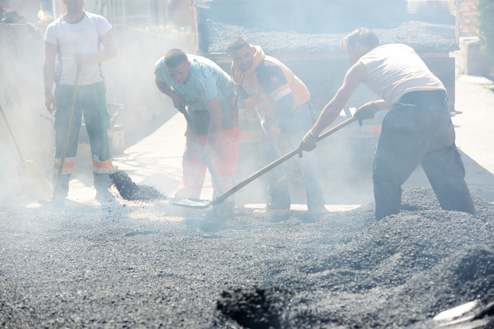 Hard work on asphalt construction