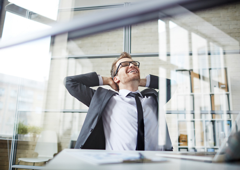 Young Businessman Dreaming During Break In Office