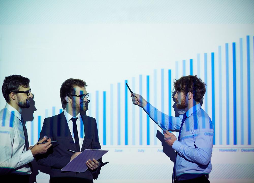 Confident Businessman Presenting His Colleagues Report Of Progress