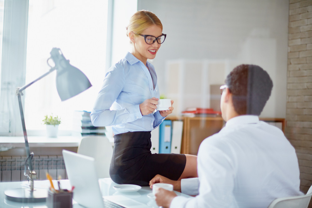 Charming Secretary Talking To Her Boss During Coffee Break
