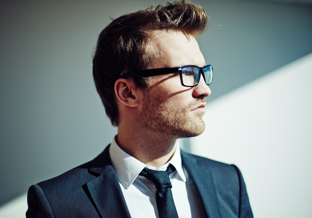 Side View Of Posh Young Man In Eyeglasses