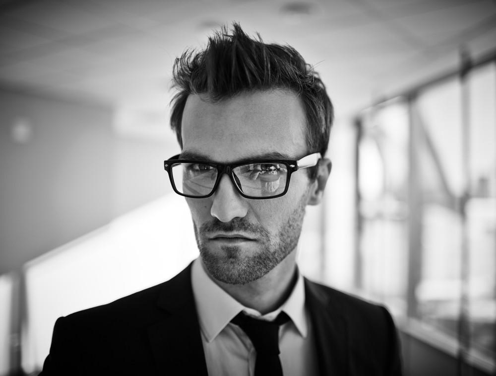 Elegant Businessman In Eyeglasses And Formalwear Looking At Camera