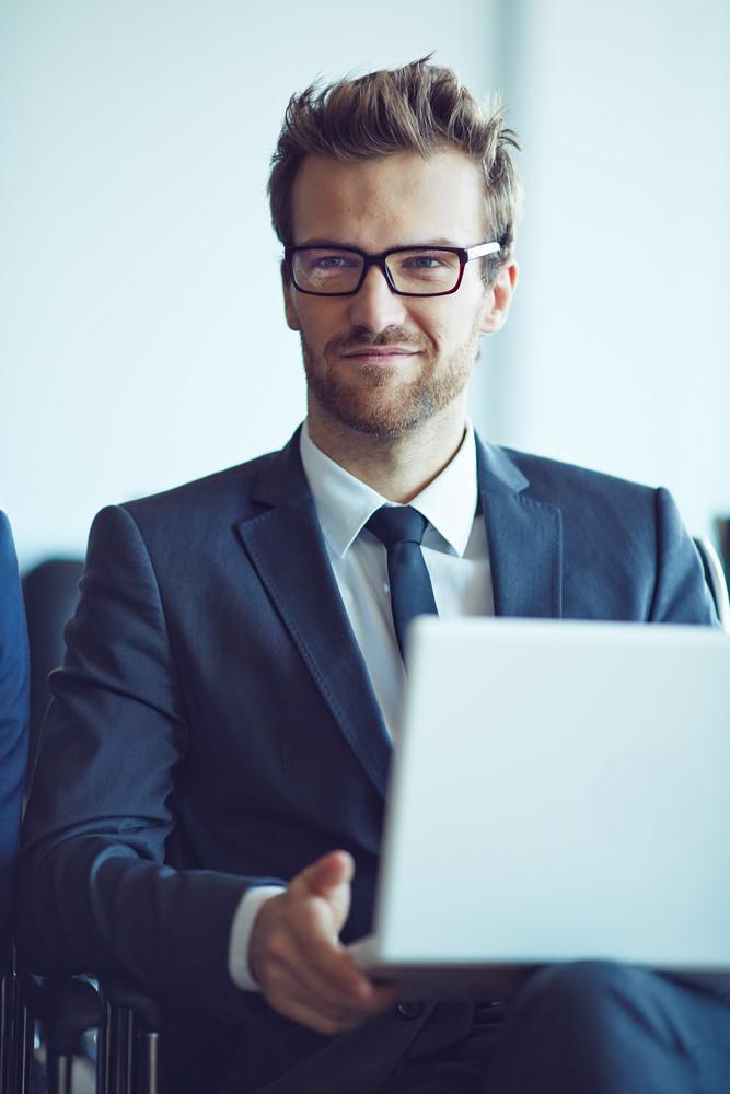 Elegant Employee With Laptop During Meeting