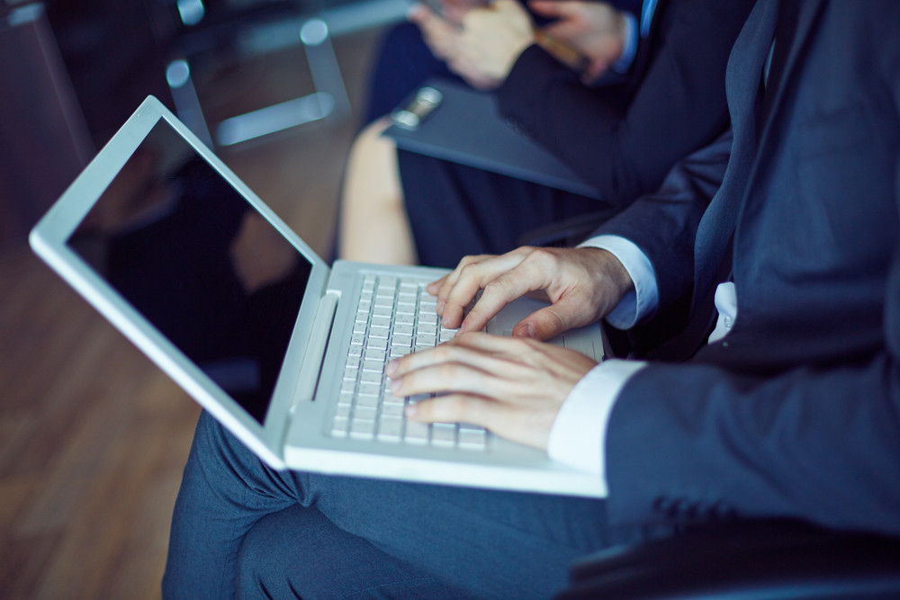 Hands Of Businessman During Typing At Conference