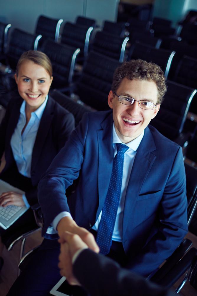 Elegant Businessman In Eyeglasses Handshaking With His Partner