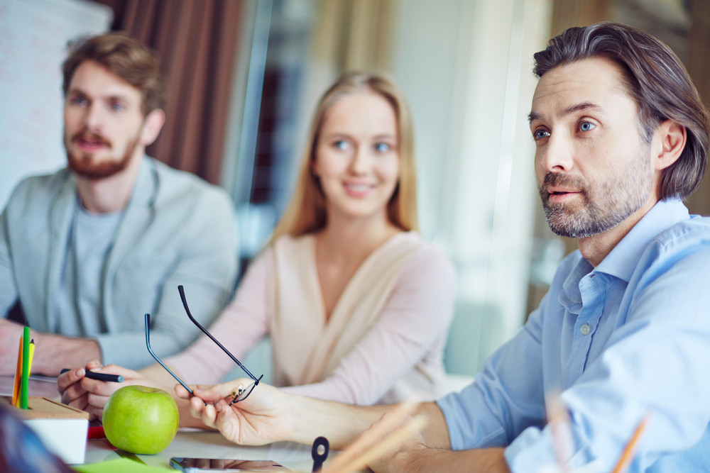 Confident Businessman Debating With Co-worker At Meeting