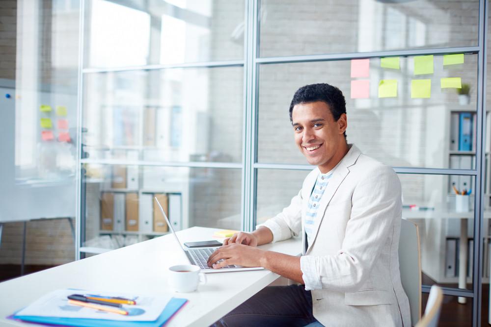 Successful Businessman In Casualwear Working In Office