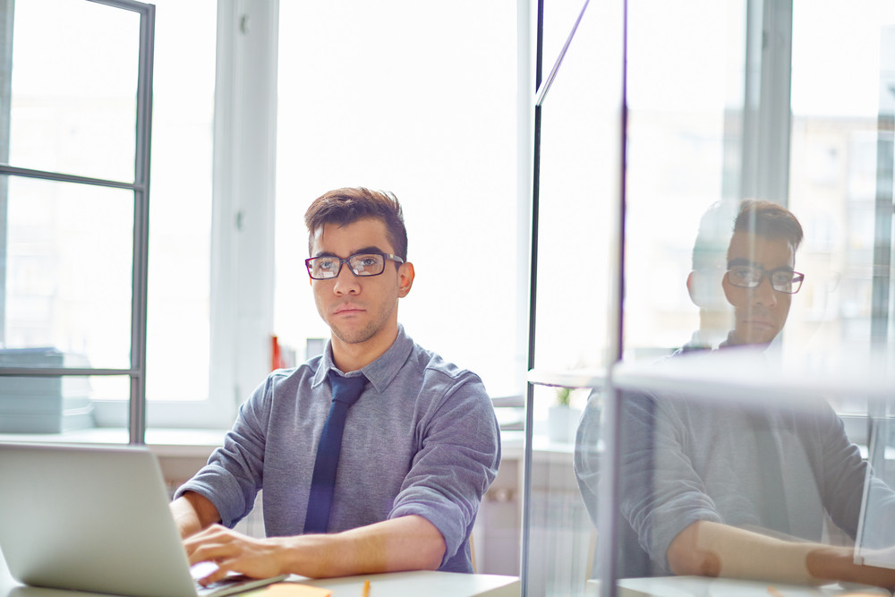 Calm Businessman In Casualwear Networking By Desk In Office