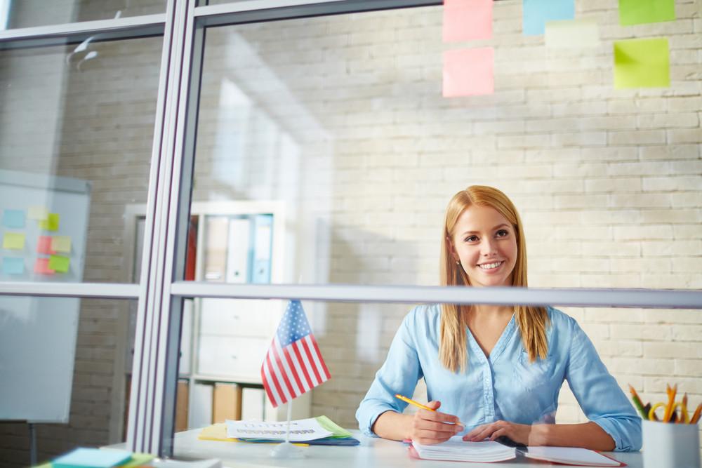 Beautiful Businesswoman Sitting At Workplace