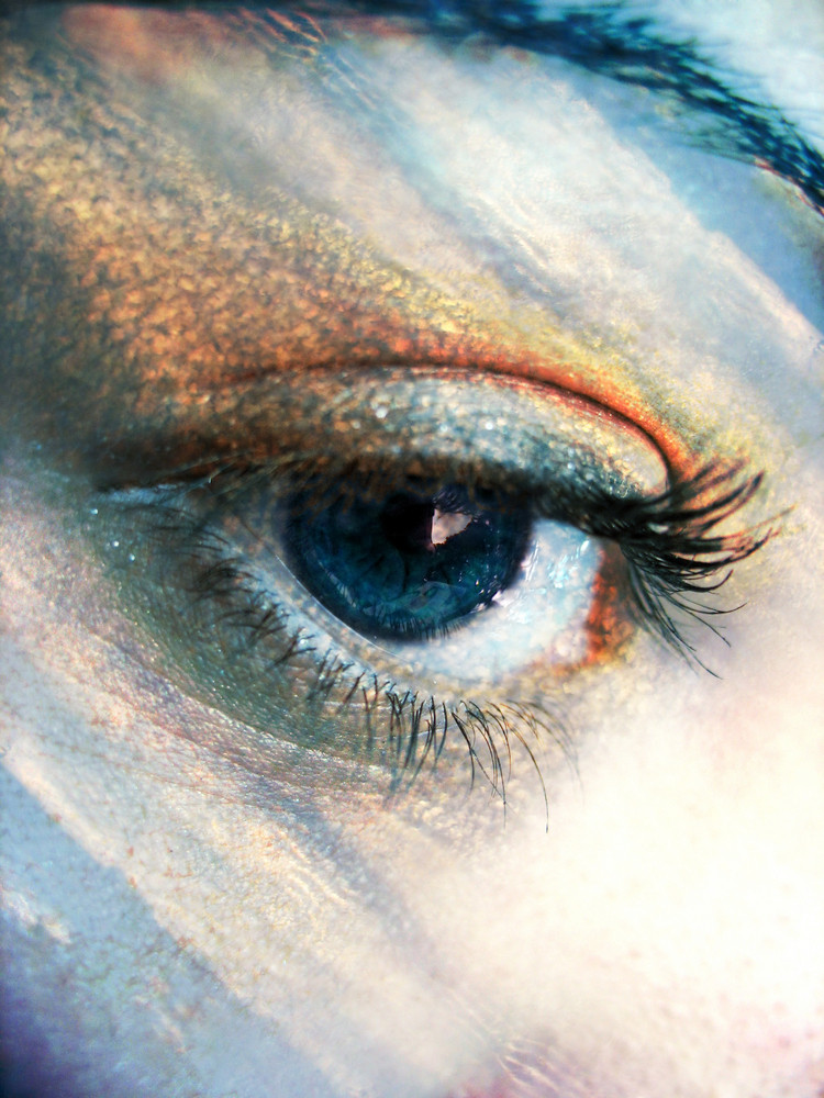 A beautiful blue eye concept with the colors of the sky added.
