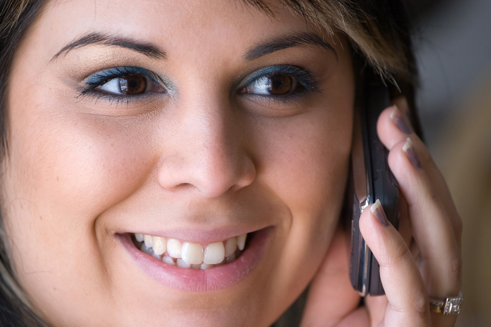 A beautiful young woman talking on her cell phone.