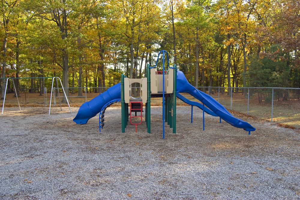 A brightly colored playscape at the park.  A fun place to be when you're a kid!