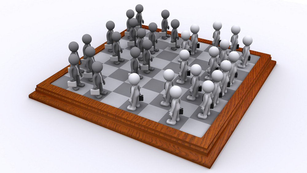 A Chess Board Of Business People. Business Strategy Concept