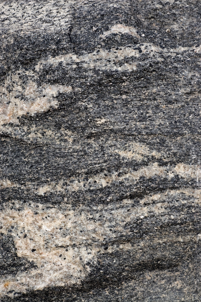 A closeup of a marble or granite stone texture.
