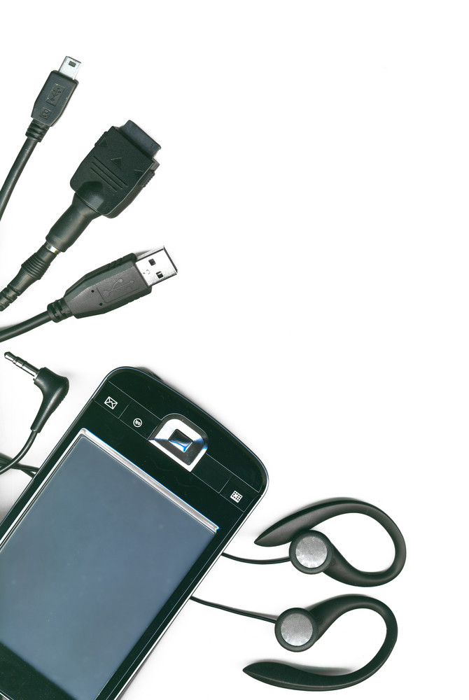 A Collection Of Different Electronic Cables And Pda On A White Background
