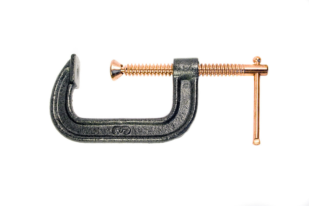 A common c-clamp isolated over a white background.  Clipping path is included.