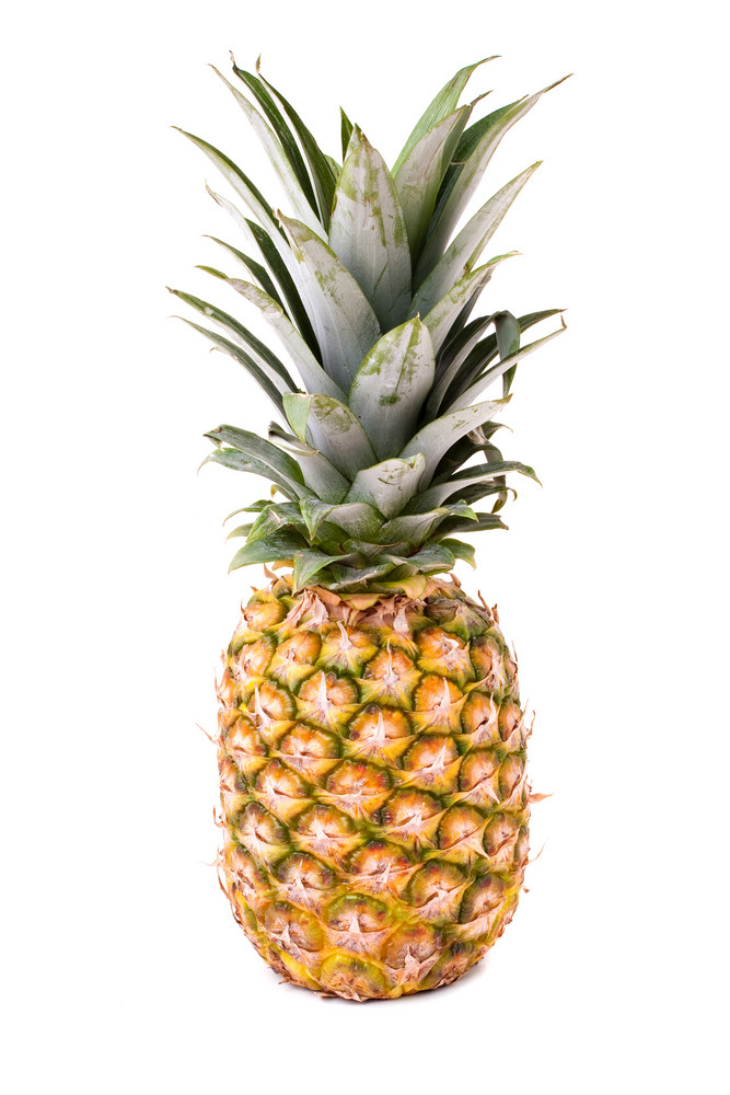 A fresh and ripe pineapple fruit isolated over a white background.