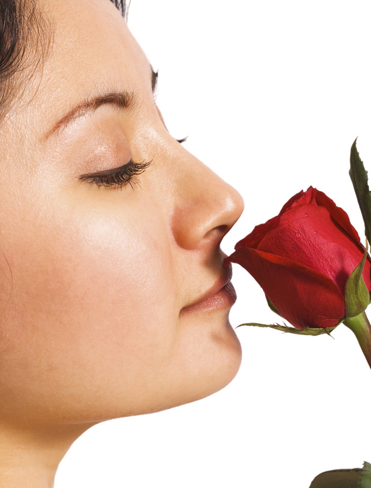 A Girl Smelling A Rose From Her Lover