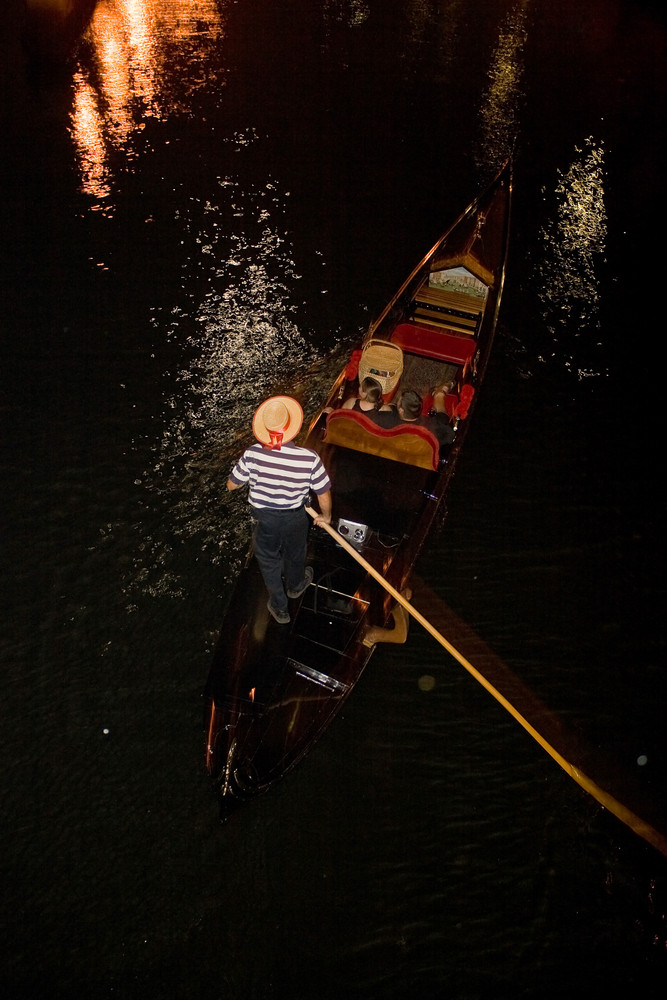A gondola on the canal at night during a Providence Rhode Island WaterFire event.