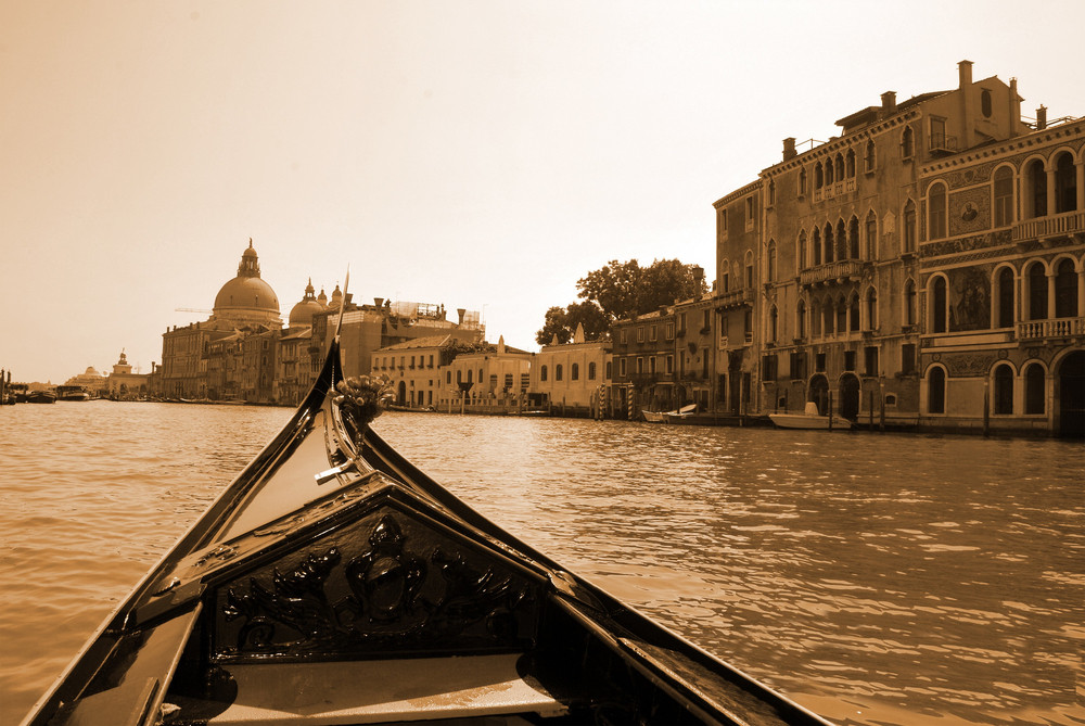 A Gondola On The Grand Canal Glides Toward