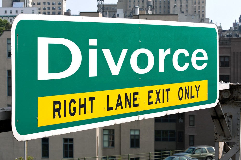 A green highway sign with the word Divorce on it.
