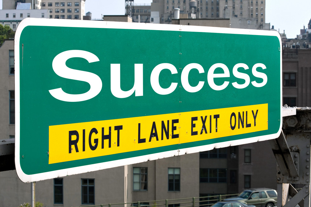 A green highway sign with the word Success on it. Great for business concepts.