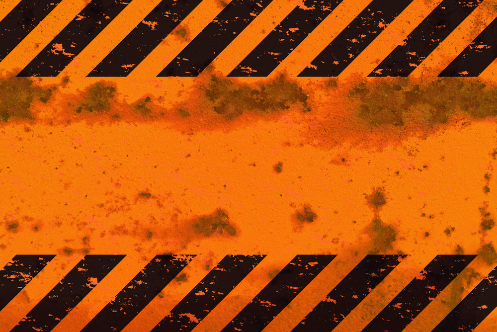 A grungy and worn hazard stripes texture.