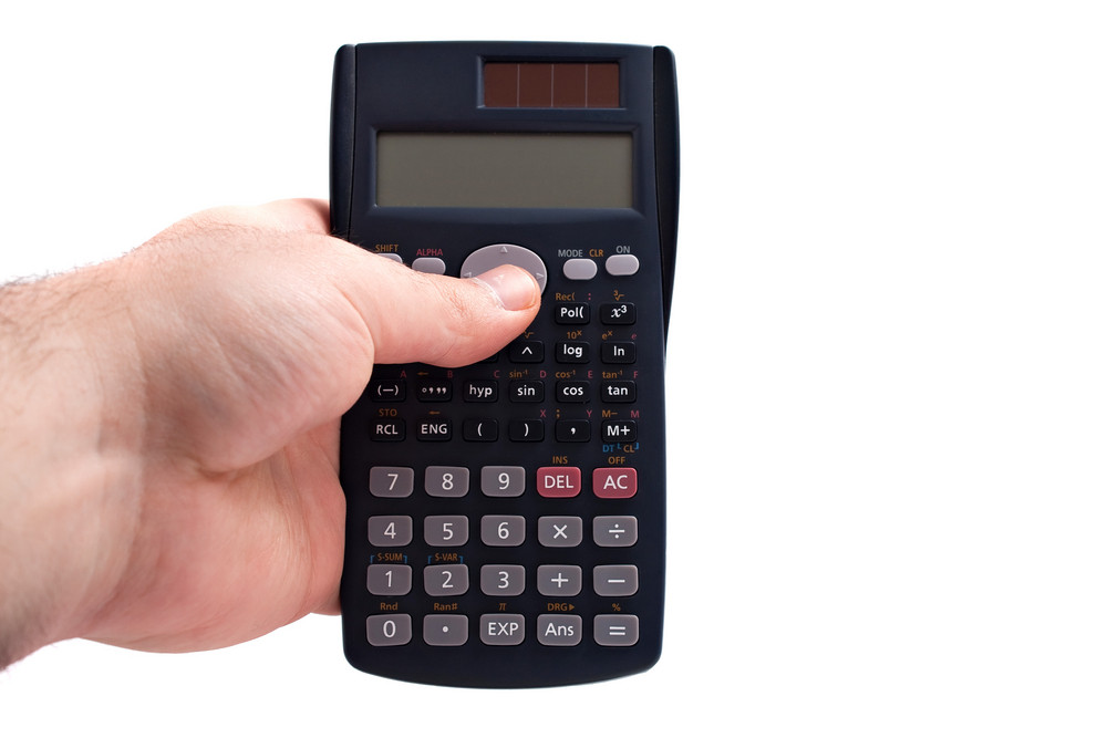 A hand holding a calculator over a white background.  The LCD screen is blank and ready for your own text or message.