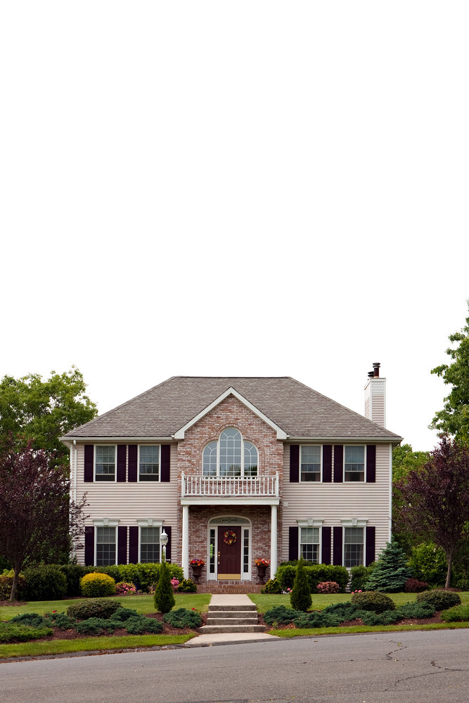 A large luxury home isolated over white.  Plenty of white negative space for your text or design.
