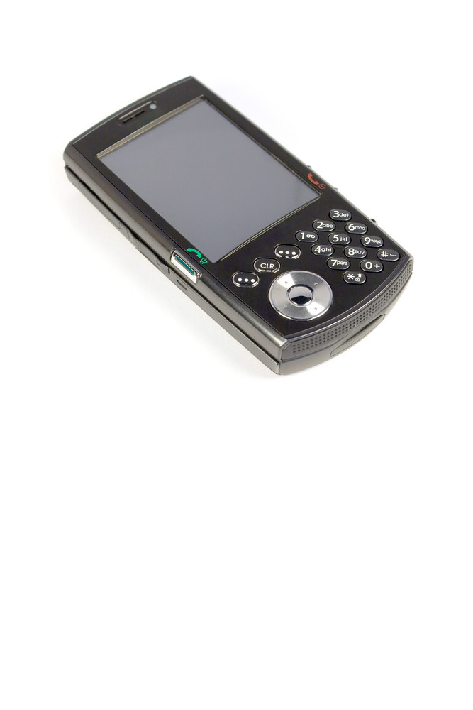 A modern cell phone isolated over white.