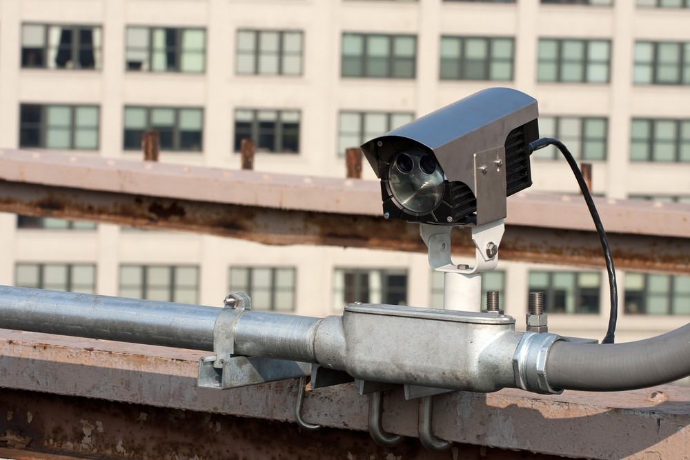 A modern day traffic cam used for surveillance by governmental law enforcement authorities.