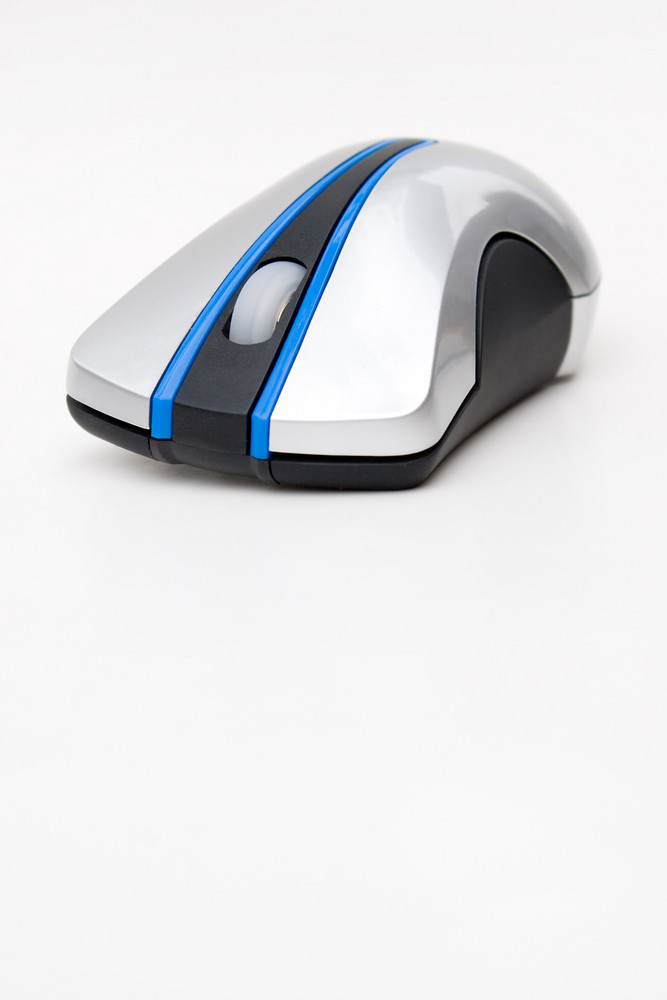A modern wireless mouse isolated over white.  Plenty of copyspace below for your text or design.