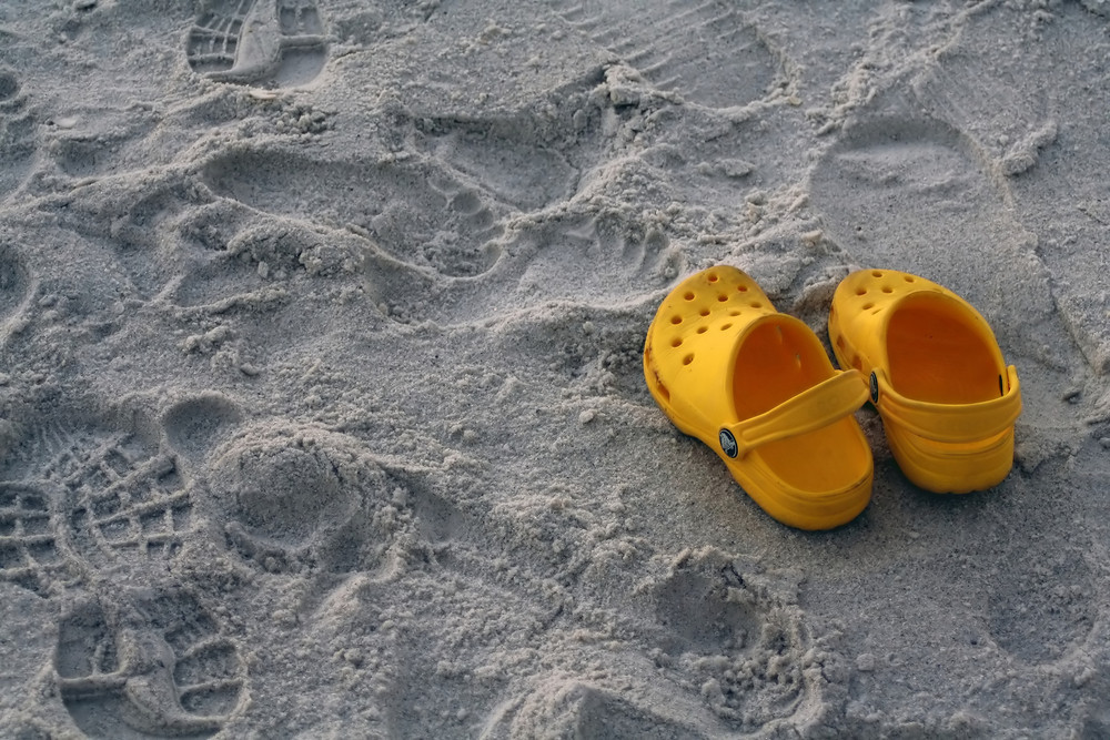 A Pair Of Sandals At The Beach