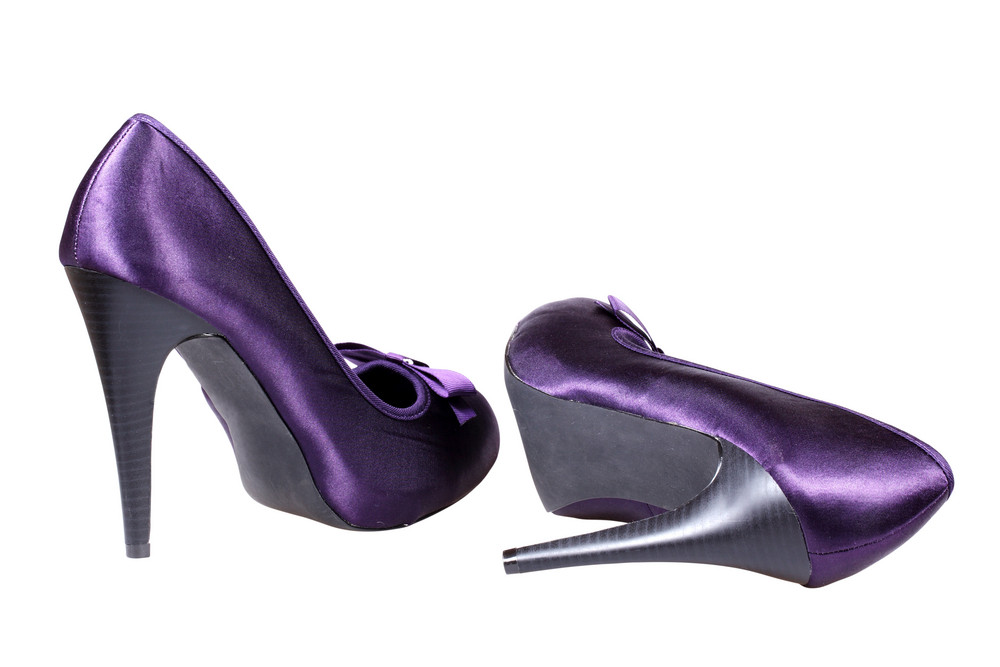 A Pair Of Violet Women's Heel Shoes