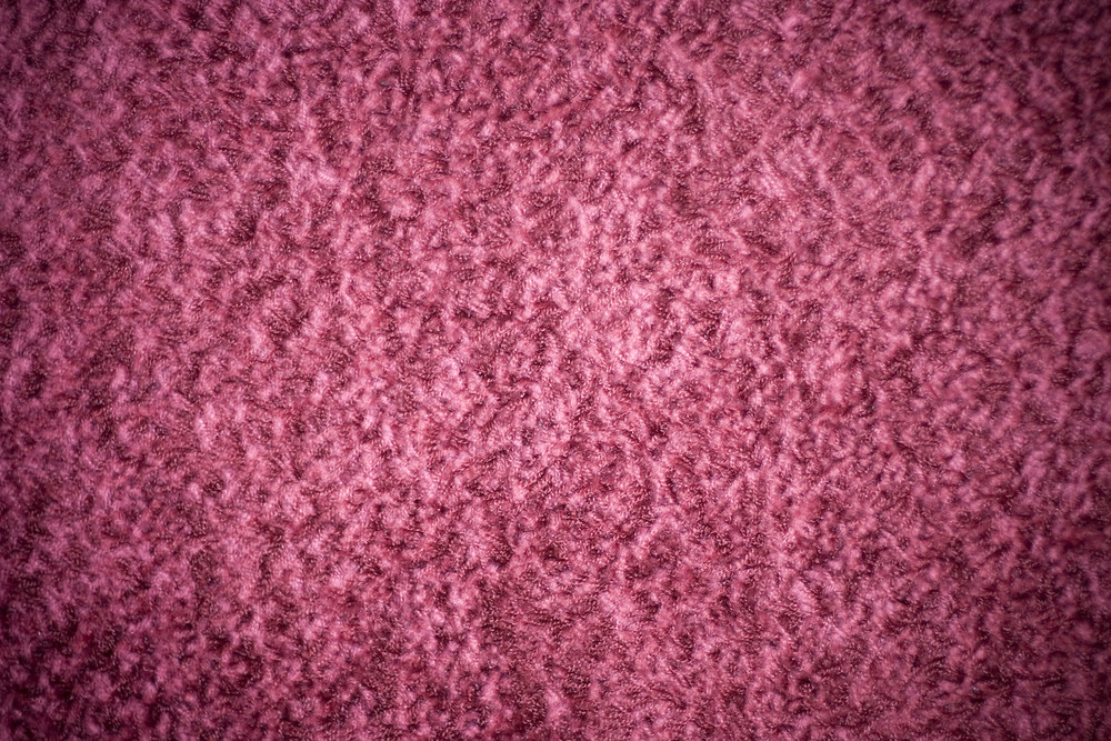 A pink shag carpet texture with added vignetting.