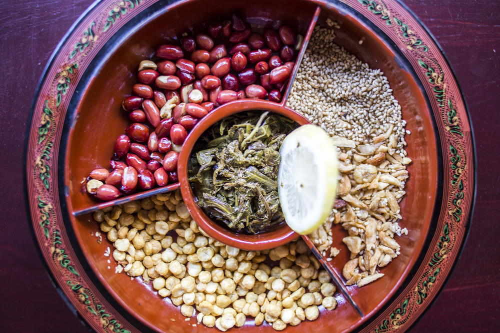 A selection of typical Myanmar snacks: tasty and spicy seeds, nuts and pickled tea leaves.