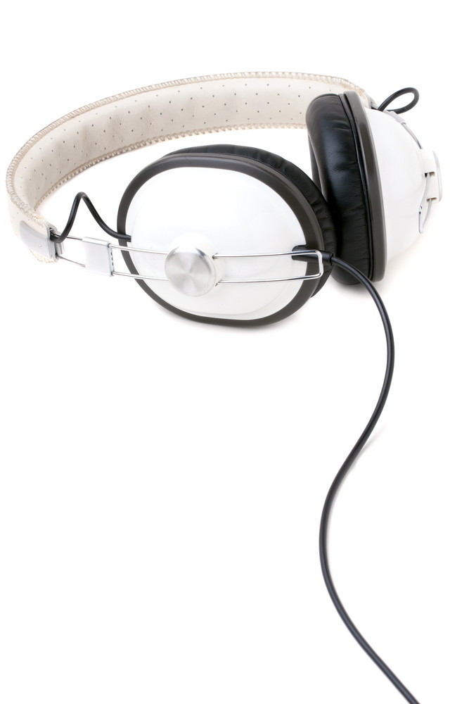 A set of retro style head phones isolated over a white background.
