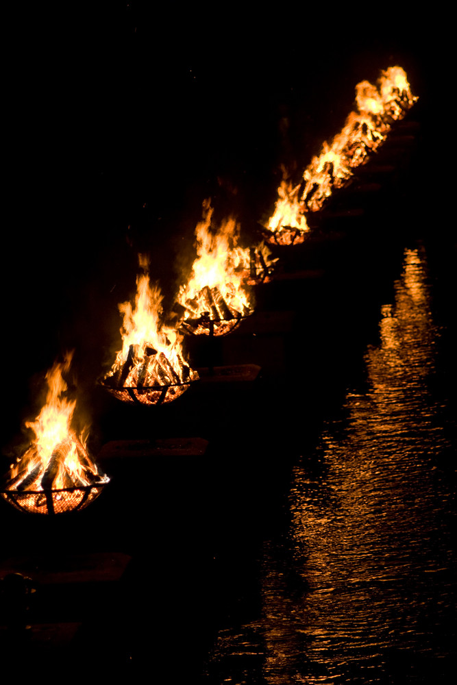 A shot of the burning bowls of fire set on the river during the annual WaterFire event in Providence