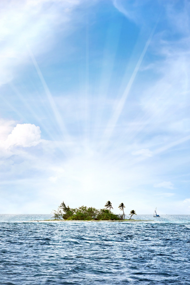 A small desert island off the coast of Puerto Rico called Palominito with bright lens flare.