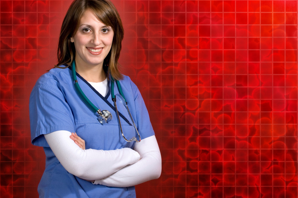 A smiling nurse or doctor over a background made up of red 3D cells.  Plenty of copy-space for your text.
